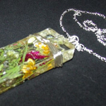 """Dried Wild Flowers Pendent , Hand picked, encased in resin, wrapped silver plated wire. Silver Plated Chain 20"""""""