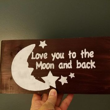 Love you to the moon and back hand-painted wood sign