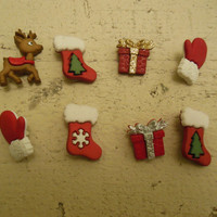 Christmas buttons for crafting or clothing. 8 buttons shaped like stockings, mittens, gift boxes, and one reindeer.