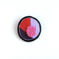Fabric brooch geometric hand embroidered lavender, purple and red colors with hot pink beads on black muslin with black felt Winter fashion