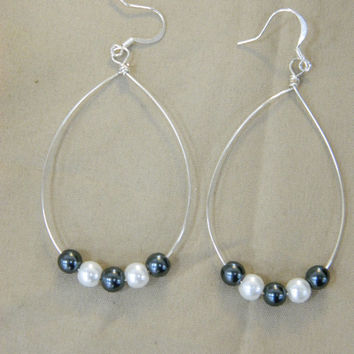 Black and white faux pearl beaded dangle earrings in silver plated wire hoop