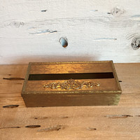 Gold tissue box holder. Gold metal kleenex cover