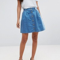 ASOS TALL Denim Button Front Mini Skater Skirt in Mid Wash Blue at asos.com