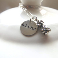 "Silver pineapple necklace with sterling silver hand stamped ""aloha"" charm and delicious pineapple charm. #pineapple #tropical #hawaii"