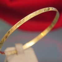 Fourteen karat yellow gold bangle bracelet dated at about 1960