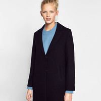 COAT WITH CONCEALED SEAMDETAILS