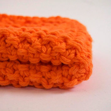 hand knit plushy cotton washcloth in bright neon orange