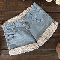 Floral Flanging Three Buckle Washed Denim Shorts$38.00