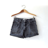 Vintage black LEVIS jean shorts. Cut off jean shorts. Distressed Faded Denim Shorts.