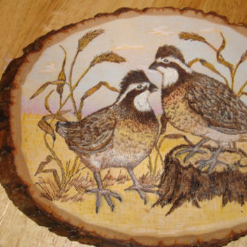 Pair of Ruffed Grouse woodburned on a basswood round and colored with PrismaColor pencils and finished with tung oil.