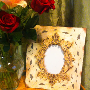 Vintage shabby chic  picture frame distressed to give it an antique appearance.