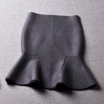 Autumn and winter new solid color embossed package Holstein tail skirt skirt