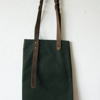 little green canvas bag with braided leather handles