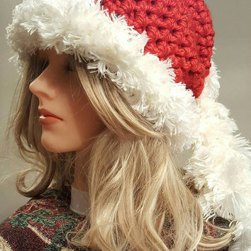 Crochet  Santa hat. Head Band. Made by Bead Gs on ETSY. White fuzzy Trim. Ladies Size. Winter.