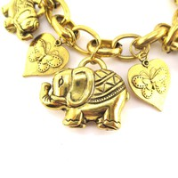 Abstract Elephant and Coins Shaped Charm Bracelet in Gold | Animal Jewelry