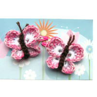 Crochet butterfly hair clips, pink and white.