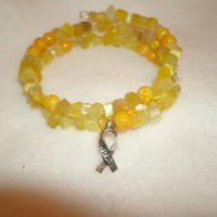 "Cancer Ribbon bracelet - yellow beads, silver ""Hope"" ribbon charm, memory wire fits most,cancer colors, cancer support, custom jewelry avail"