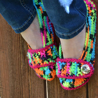 Crochet slippers, booties, shoes, socks with a button strap, colorful variegated tie dye spring collection in neon blacklight