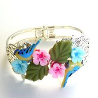 Hand painted bird with resin flower and leaves bracelet