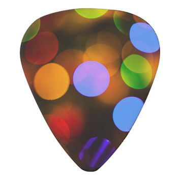 Multicolored Christmas lights. Guitar Pick