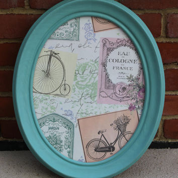 Teal oval picture frame or wall decor with Parisian print
