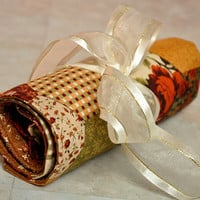 travel cosmetic, and toiletry roll -- autumn colored patchwork print, makeup, jewelry, art supplies