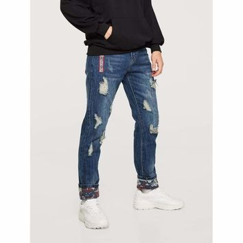 Destroyed Rolled Hem Jeans by Bare Culture Apparel