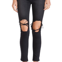 UNIF Peach Pit Skinnies in Black