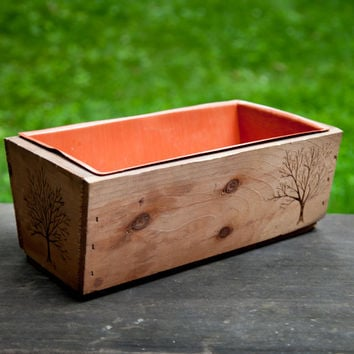 Found wooden planter with plastic insert embellished with wood burned tree designs. Window box plant holder