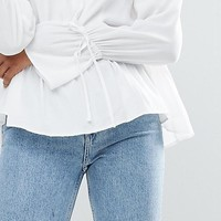ASOS Oversized Wrap Blouse with Dip Hem at asos.com