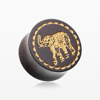 A Pair of Tamarind Wood Golden Elephant Ear Gauge Plug
