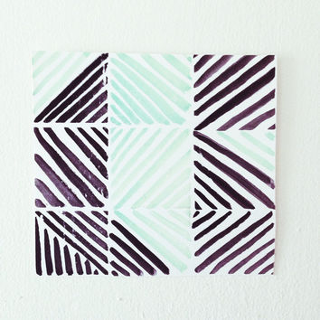Geometric mint and black striped painting