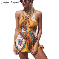 Simplee Apparel Sexy backless lace up summer elegant jumpsuit romper Hollow out women playsuit beach Boho floral print overalls