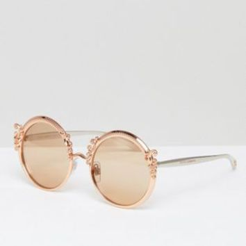 Dolce & Gabbana round sunglasses with baroque detail in gold at asos.com