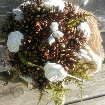 Pinecone bouquet and bout with added eyelet hand rolled flowers and greens! beautiful rustic and romantic