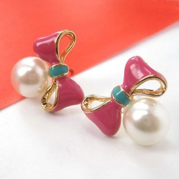 Small Bow Tie Ribbon Knot Studs in Pink with Pearl Detail