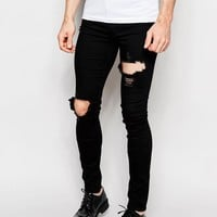 ASOS | ASOS Spray On Jeans With Extreme Rips In Black at ASOS