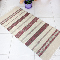 Handwoven wool rug in white, brown and pastel purple, striped and geometric handmade boho rug