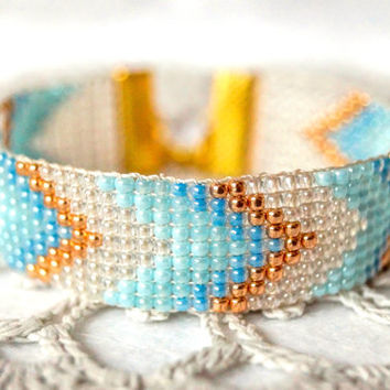 Bead loom bracelet,  chevron bracelet, light blue , transparent ,rose gold czech glass beads, wide geometric  bracelet, lucky clover