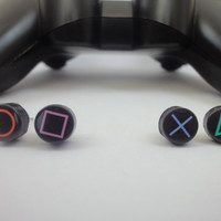 Upcycled playstation controller button earrings by artandchill