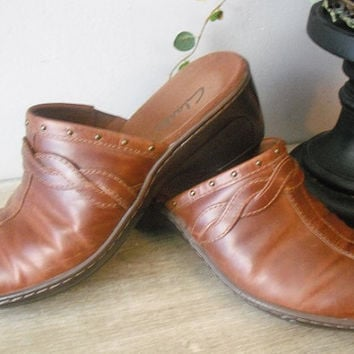 vintage brown leather Clarks clogs with Brass stud details size 7 M
