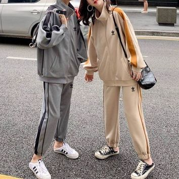 """""""Adidas"""" Woman's Leisure Fashion  Letter  Personality Printing Zipper Spell Color Stripe Long  Sleeve Tops Trousers Two-Piece Set Casual Wear"""