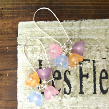 Pink, purple, blue and peach color. Lucite flowers, silver beads, simple silver earrings.
