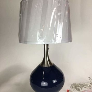 A Pair of Spencer Blue Lamps With White Shades