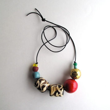 Beaded necklace with Native American glass beads geometric African horn beads brass and wood beads