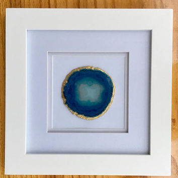 "Blue agate geode slice with gold edges in 10""x10"" white frame"