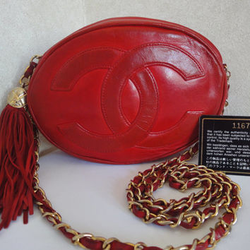 Vintage CHANEL red oval shape large CC calfskin chain shoulder bag purse with golden CC ball and tassel. One of the most popular bags.