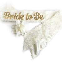 """Bride To Be"" White Lace & Satin Bachelorette Party Sash With Flower Pin Accessory - Also for Hen Party Bridal Shower Luncheon"