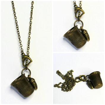 Peter Pan and Wendy Thimble and Acorn Hidden Kisses Necklace Brass