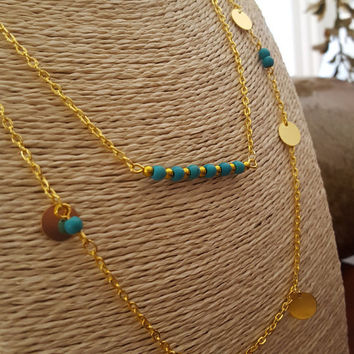 Beautiful gold plated double chain necklace and turquoise beads and gold sequins